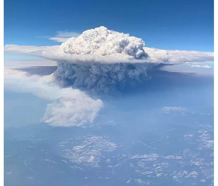 An aeriel view taken from a flight passenger shows a great huge puff of smoke across the state. It is viewable from space.